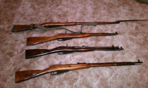 Picture of mosins nagant, two 91/30, M44 with a bayonet and a M38